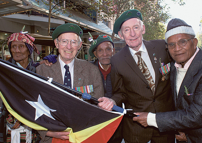 Sergeant Ralph Coyne (left) poses with criados (left to right) Armind Monteiro, Rufino Conciro, and Manuel Ximenes along with another Sparrow Force commando, John Jones, during an emotional reunion in April 2006.