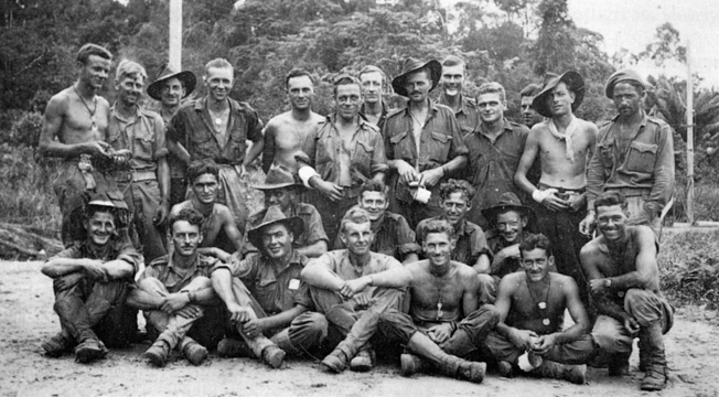 Veteran commando Ralph Coyne (standing second from right) is shown with other members of 2/4 Com- mando Squadron, which saw heavy action in several battles against the Japanese.