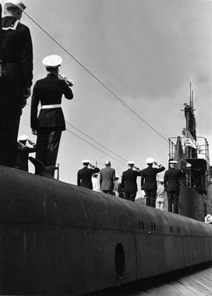 Officers salute as a bugler plays during the commissioning of the submarine USS Dace at New Landon, Connecticut, on July 21, 1943. Dace went on to compile an impressive wartime record.