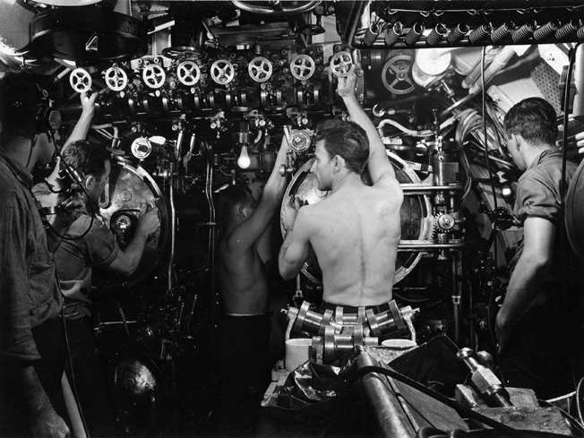 The cramped quarters of a U.S. submarine may be seen in this view of the torpedo room aboard the USS Cero. Submarine duty was among the most hazardous in World War II.