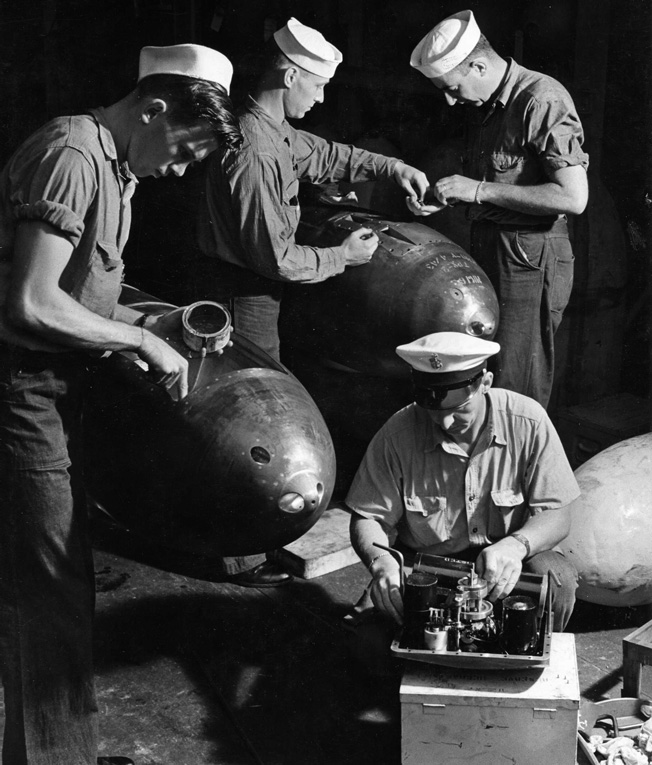 The warheads of several American torpedoes are given final checks prior to loading aboard a U.S. submarine at its New Landon, Connecticut, base in July 1943.