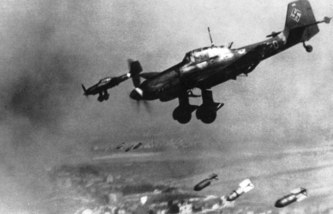 German Junkers Ju-87 dive bombers drop their lethal loads on Soviet troop and armor concentrations below. When Soviet General S.I. Cherniak committed his armored reserve, the Stukas of StG-77 led waves of German aircraft that hit their assembly areas and destroyed 48 of the 98 Soviet tanks in the area. The surviving armored vehicles were compelled to retreat.