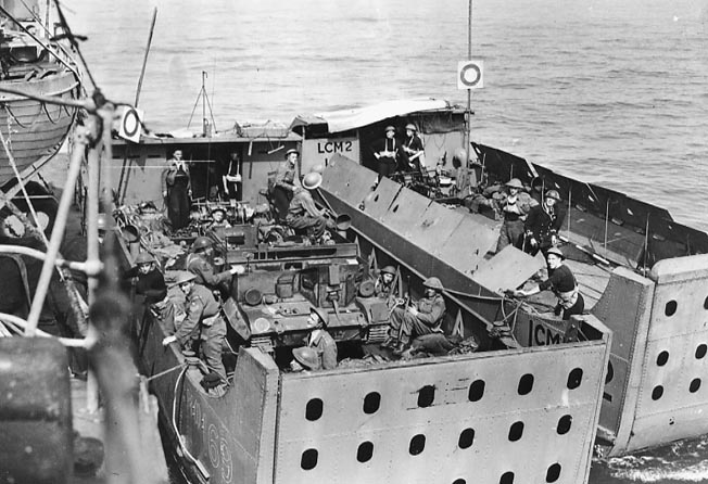 Two Royal Navy landing craft filled with men and Bren carriers photographed from a destroyer prepare the for assault.