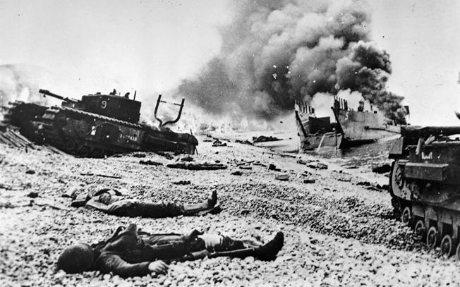 The bodies of crewmen lie sprawled around their vehicle.