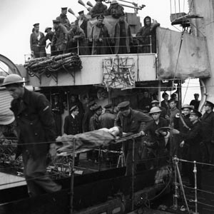 Wounded Canadians are carried off a Polish destroyer after returning from Dieppe.