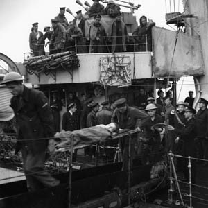 A wounded Canadian soldier is disembarked from a Polish destroyer after taking part in the landing actions.