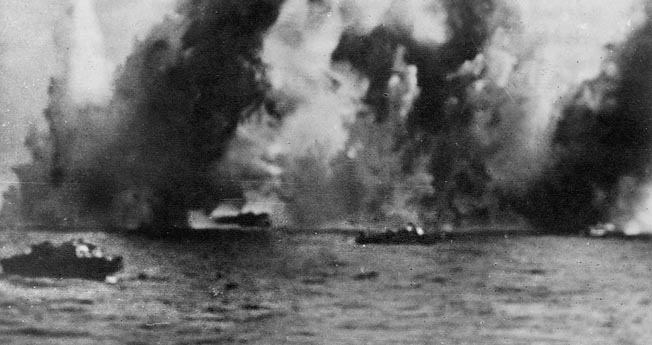 Royal Navy landing craft on the approach to the beaches dodge intense German coastal artillery barrage.