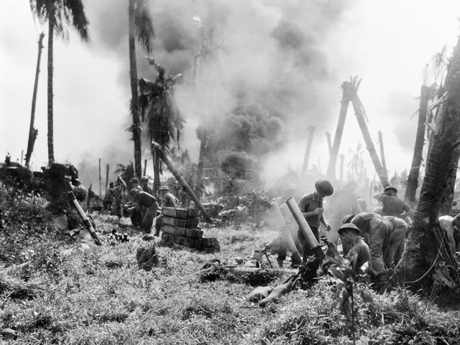 Australian soldiers fire their mortar at Japanese positions near Balikpapan on the island of Borneo.