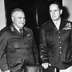 General Sir Thomas Blamey, commander of the Australian Army troops engaged in the Pacific, confers with American commander General Douglas MacArthur.
