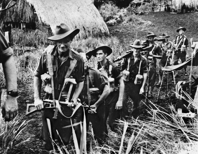 Moving into the jungle of New guinea in search of Japanese resistance, this Australian patrol is heavily armed. Resupply was difficult, and the soldiers were often required to carry enough supplies and ammunition to sustain them for prolonged periods.
