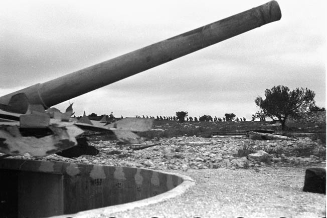 Photographed in 1942, this heavy German coastal gun battery along the Riviera looks formidable but did little to impede the Allied invasion.