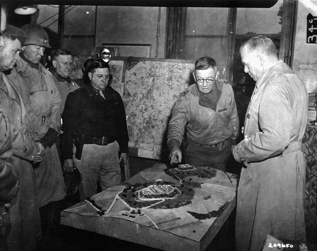 Meeting at 5th Infantry Division HQ, Metz. (left to right) Lt. Gen. Thomas T. Handy , Lt. Gen. George S. Patton, Jr., Maj. Gen. Hiram C. Walker, Maj. Gen. S. Leroy Iwin, Gen. George C. Marshal.
