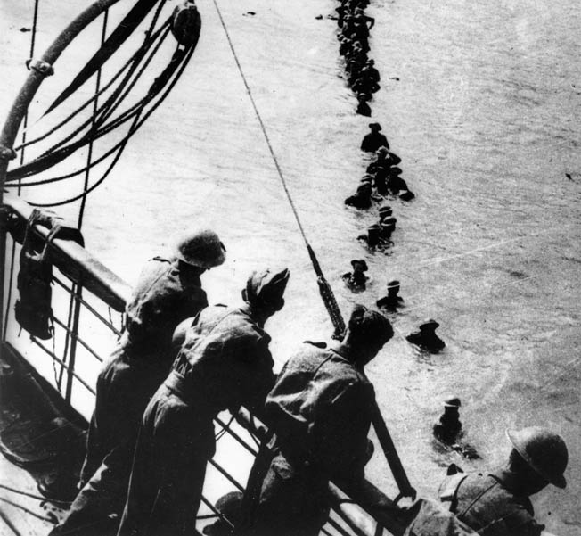 British soldiers wade out to a ship at Dunkirk.