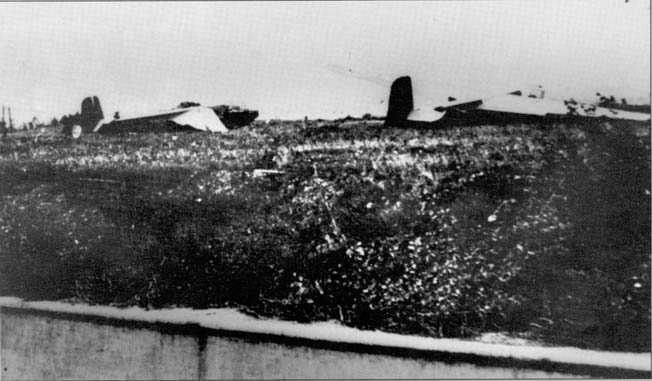 German troops cross the Albert Canal as an artillery round smashes into Eben-Emael's 40-meter-tall walls.
