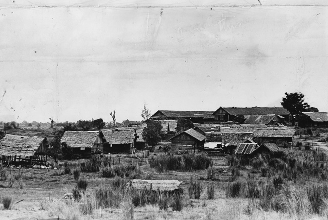 Following the arduous Death March, Ed Dyess was held for two months at Camp O'Donnell on Luzon before being transferred to Cabanatuan. This photo shows Camp O'Donnell in 1945, after the facility was abandoned by the retreating Japanese.