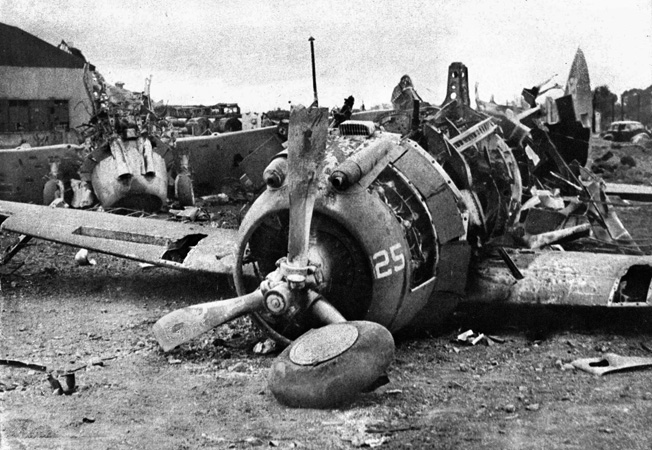 Following a Japanese air attack on December 10, 1941, obsolete American P-35 fighter planes lie destroyed on the ground at Nichols Field in the Philippines. When Ed Dyess and his squadron arrived in the Philippines, the P-35 constituted much of the U.S. fighter strength.