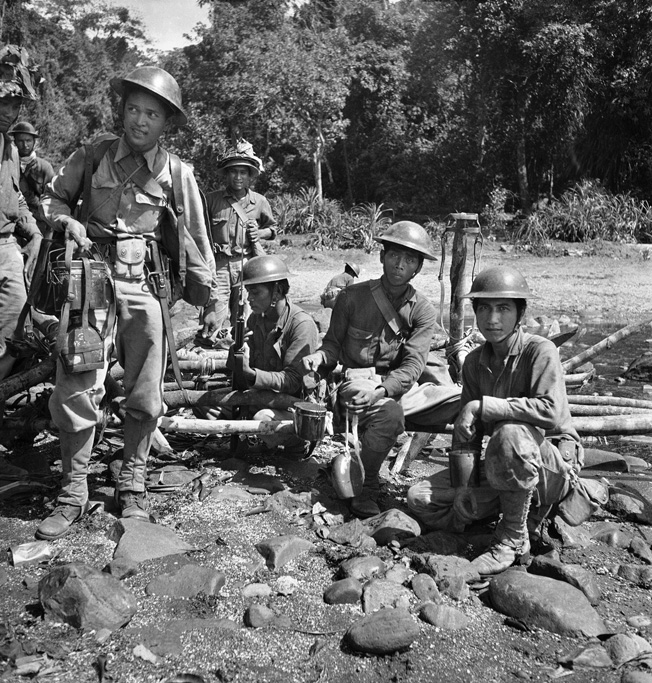 10 Apr 1942, Philippines --- Victorious Filipino scouts after cleaning out Japanese on point on western Bataan Coast in Philippines on April 10, 1942. (AP Photo/Clark Lee) --- Image by © Clark Lee/AP/Corbis