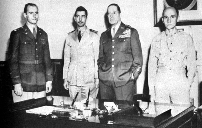 Promoted to the rank of lieutenant colonel, Ed Dyess (left) and fellow escapee U.S. Navy Lieutenant Commander M.H. McCoy (center) meet General Douglas MacArthur at his headquarters in Australia.