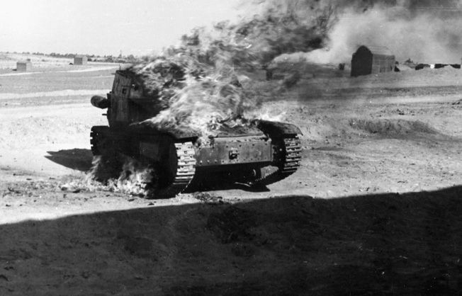 A burning German tank marks the line of retreat from El Alamein.