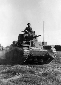 Its commander riding in an open hatch, a German tank moves toward the front.