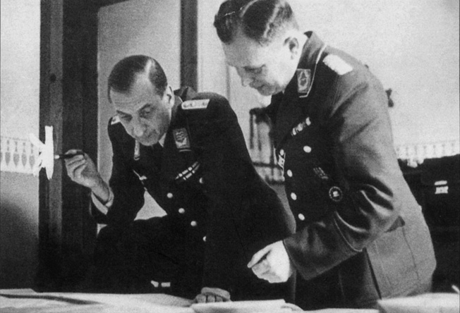 Almasy, in Hungarian uniform, and Major Nikolaus Ritter pore over maps of North Africa at Abwehr headquarters in Hamburg.