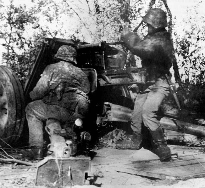 "Artillerymen from the 12th SS Panzer Division ""Hitlerjugend"" fire a 75mm PAK 40 antitank gun at Allied soldiers."