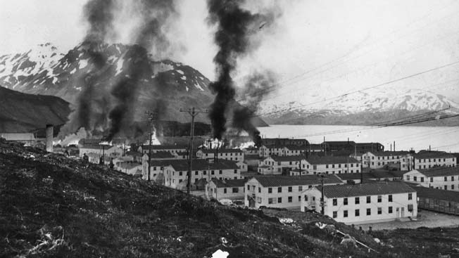 Buildings burn at Fort Mears following the June 3rd hit-and-run attack on Dutch Harbor. Twenty-five defenders were killed during the 20-minute attack.