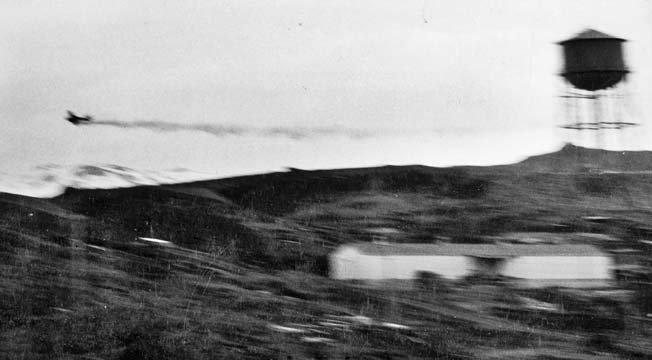 Streaming smoke from a damaged engine, a Japanese plane appears headed for trouble. At least one Japanese Zero was downed during the attack on Dutch Harbor.