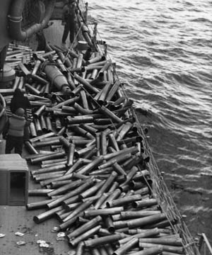 Hundreds of shell casings litter the deck of the cruiser USS Honolulu, evidence of the heavy bombardment of Kiska prior to the landing of Allied forces on August 8, 1942.