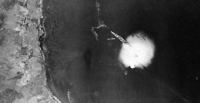 A bomb explodes near a Japanese warship off Kiska Island during raid by U.S. Army Air Force bombers, October 9, 1942.