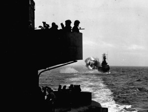 A salvo from the cruiser USS Indianapolis is loosed against reported Japanese positions on Kiska. Photograph taken on the USS Salt Lake City.