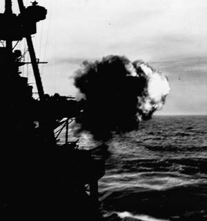 The cruiser USS Salt Lake City blasts enemy positions on Kiska in support of 35,000 U.S. and Canadian troops who stormed the beaches, August 1943.