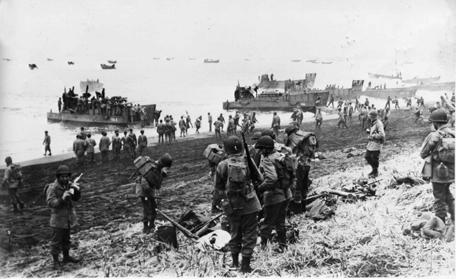 American troops and supplies are landed on the beach at Massacre Bay on Attu. Massacre Bay was one of the two locations where Allied soldiers came ashore and succeeded in cornering the Japanese.