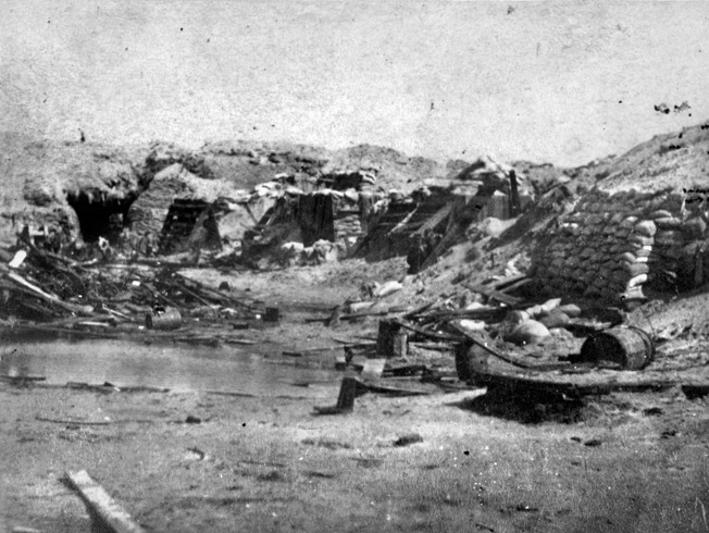 A period photograph shows the Confederate fortifications at Fort Wagner. The Confederates ultimately abandoned the fort in September 1863 after continued pressure from Union forces.