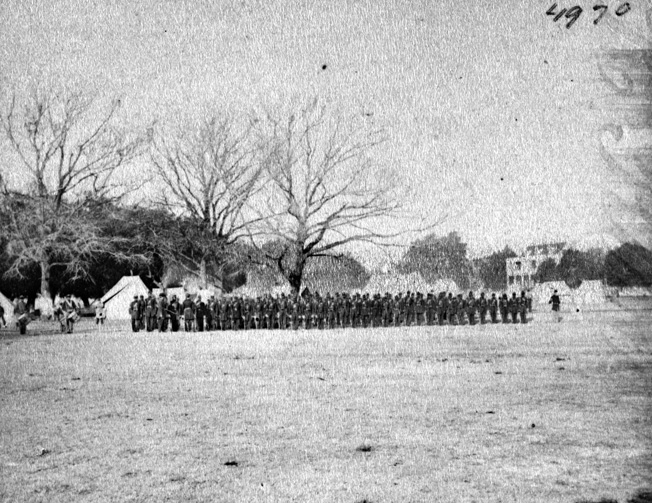 The 1st South Carolina Regiment of U.S. Colored Troops is shown on parade in Beaufort, South Carolina, in a period photograph.
