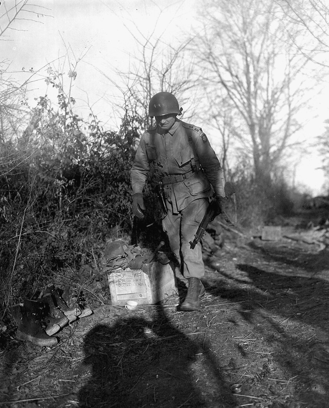 Maj. Gen. James Gavin negotiates a well-trodden path in Belgium during the beginning phases of the Battle of the Bulge.