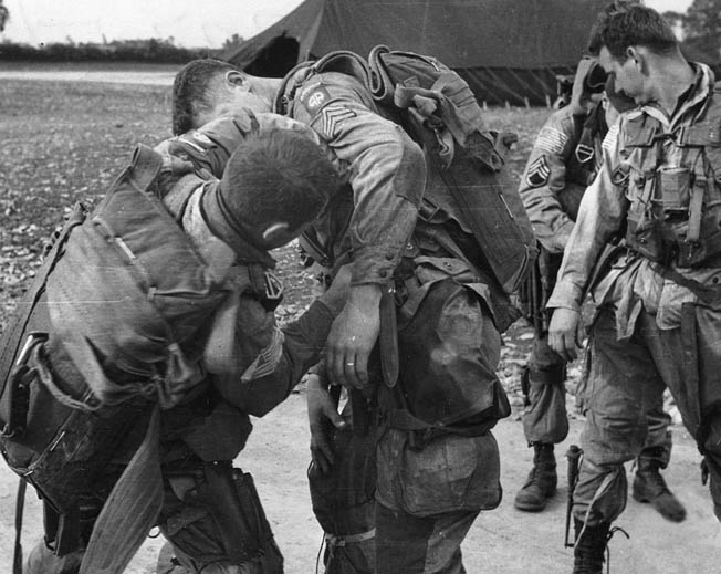 Men of the 82nd adjust gear before boarding their transports on June 5, 1944.
