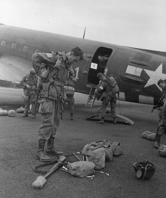 Adjusting his parachute pack, James Gavin prepares to jump into Holland during Operation Market Garden in September of 1944. Despite being injured in the jump, Gavin retained command of the 82nd Airborne.