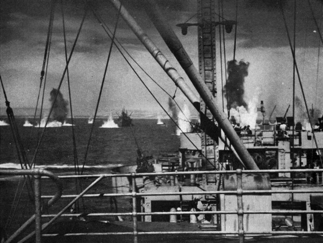 The Luftwaffe made its presence felt, deadly at times, during the Allied invasion of Sicily. In this photo, German bombs fall perilously close to Allied ships supporting the landings on the Mediterranean island in July 1943.