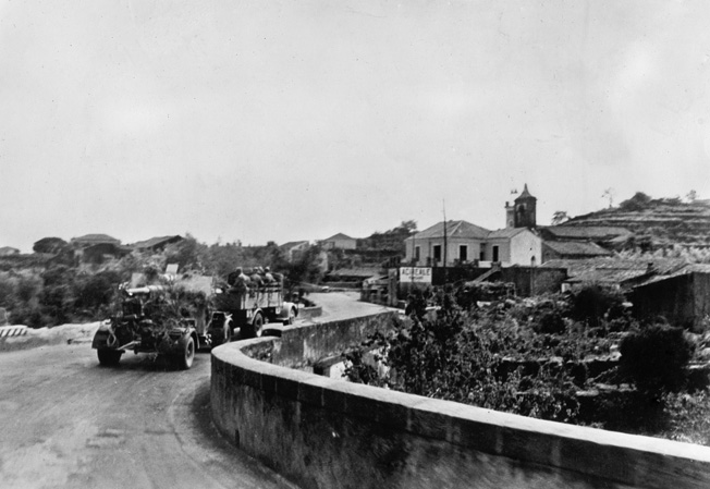 WWII: SICILY, 1943. German anti-aircraft guns on the road in Sicily, Italy, during the Allied invasion of Sicily. August, 1943.