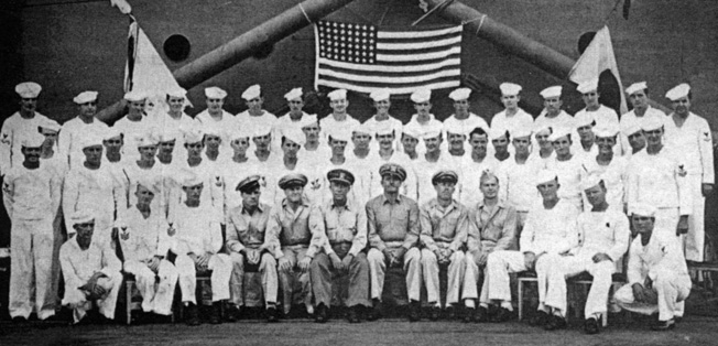 During a quiet period, the crew of the USS Goodhue poses for a portrait. Twen- ty-one crewmen were killed in action and more than 100 wounded off Okinawa.