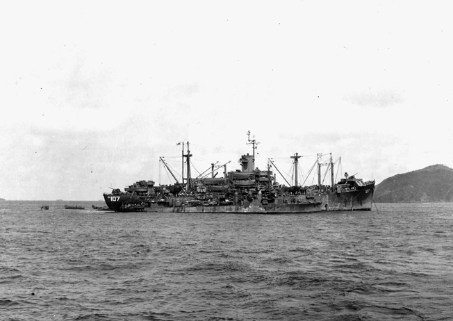 The destroyer USS Howard comes alongside the attack transport USS Goodhue, which lies at anchor. The Goodhue was among hundreds of U.S. Navy ships that were assailed by Japanese kamikazes off Okinawa in April 1945.