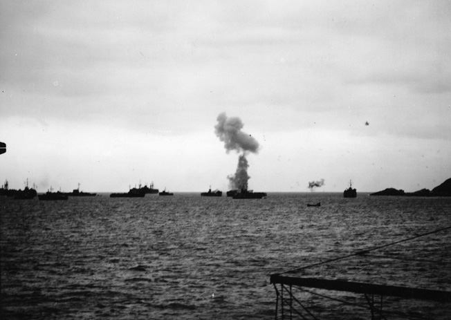Smoke billows from a U.S. vessel that has just sustained a bomb hit during a Japanese air raid off Okinawa. This photograph was taken from the deck of the transport USS Chandeleur. (