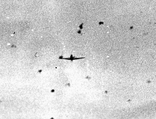 Caught in the gun camera of an attacking American fighter plane, this Japanese dive-bomber was one of hundreds of kamikazes that assaulted the U.S. fleet off Okinawa. A relative few got through the curtain of antiaircraft fire and covering fighters but managed to inflict heavy damage.