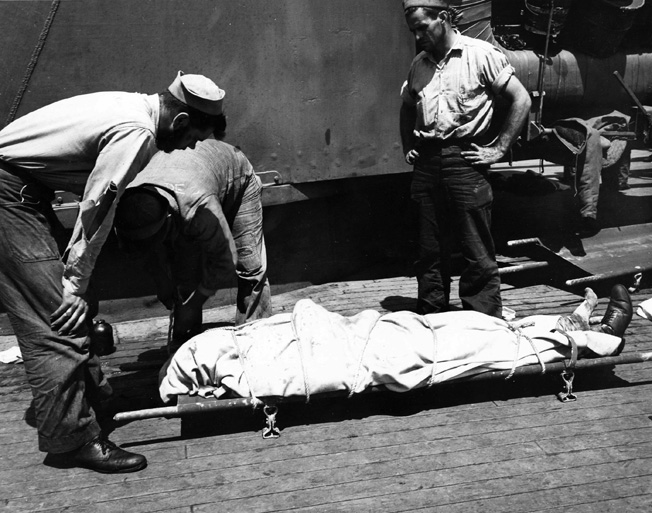 The efforts of Navy corpsmen were not enough to save the life of this American sailor, who died during a naval battle in the Pacific.