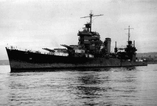 Damaged during the savage naval battles around the island of Guadalcanal, the cruiser USS San Francisco arrives at Pearl Harbor to undergo repairs.d