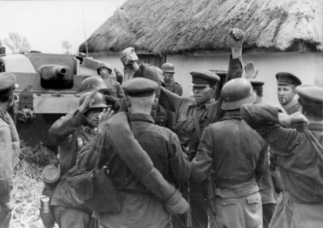 German infantrymen question Red Army prisoners and round up villagers after capturing a small settlement in the Ukraine during their 1941 advance. German infantrymen question Red Army prisoners and round up villagers after capturing a small settlement in the Ukraine during their 1941 advance.