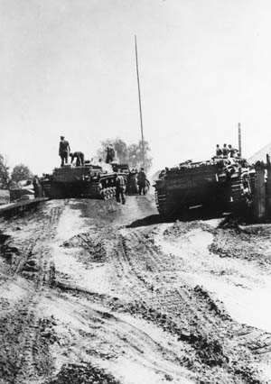 German tank soldiers survey the muddy quagmire in the immediate vicinity as they pause near the banks of the Dneiper River in the Ukraine. During the conquest of the region, elements of the 17th Army crossed the great river at the end of August 1941.