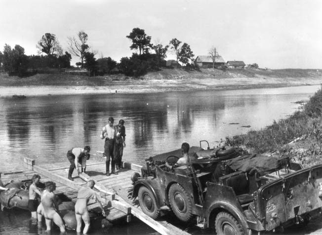German engineers construct a bridge across a stream somewhere in the Ukraine during their advance in the summer of 1941. The engineers were also experienced combat troops.