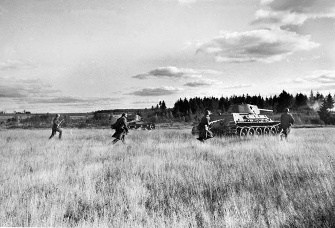 Soviet tanks and infantrymen advance across open ground during their effort to stem the German tide in the Ukraine. The Red Army suffered heavy casualties and yielded significant territory to the invaders.